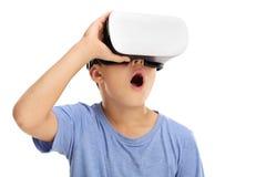 Amazed boy experiencing virtual reality. Amazed little boy experiencing virtual reality isolated on white background Stock Photography