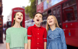 Amazed boy and girls looking up over london city Stock Image
