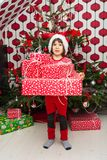 Amazed boy holding many presents Stock Photos