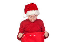 Amazed boy looking in the Christmas bag Royalty Free Stock Photo