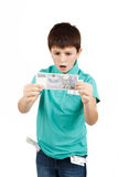 Amazed boy looks at the bill Royalty Free Stock Images