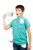 Amazed boy looks at the bill. From czech crown banknotes Royalty Free Stock Image