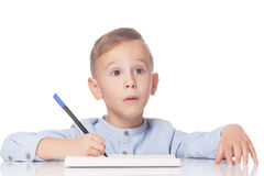 Amazed boy with pen Stock Photography