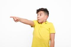 Amazed boy pointing on side Royalty Free Stock Photo