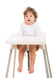 Amazed boy standing straight in chair Stock Image
