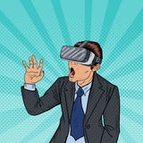 Amazed Business Man in Virtual Reality Goggles. Pop Art Royalty Free Stock Photography