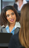 Amazed Business Woman. Amazed Black women talking with friend in restaurant Royalty Free Stock Image