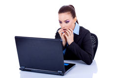 Amazed business woman at her laptop Royalty Free Stock Photo