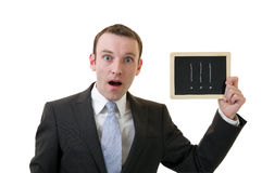 Amazed businessman. Holding a blackboard with exclamation mark Stock Photography