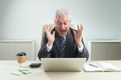 Amazed businessman. Emotional businessman shocked with news he is reading online Stock Photography