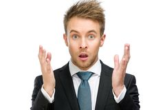 Amazed businessman with hands up Stock Images