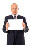 Amazed businessman holding your message stock images