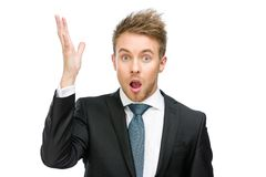Amazed businessman with open mouth and hand up. Half-length portrait of amazed businessman with open mouth and hand up, isolated on white Royalty Free Stock Images