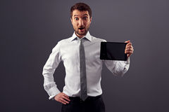 Amazed businessman showing the tablet pc Stock Photo