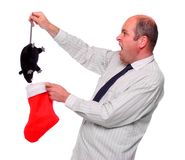 Amazed businessman with unusual christmas bonus. Royalty Free Stock Images