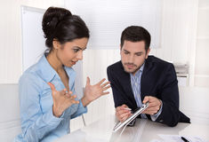 Amazed businesswoman in blue with her boss looking at tablet screen. stock images