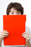 Amazed businesswoman with red file. stock photos