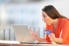 Amazed buyer finding online offers on laptop royalty free stock images