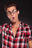 Amazed casual man. Looking at the camera on black background Royalty Free Stock Images