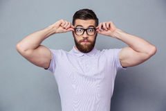 Amazed casual man looking at camera Stock Images
