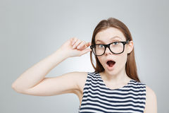 Amazed charming teenage girl in glasses with mouth opened over Stock Image