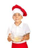 Amazed chef boy. Holding dough isolated on white background Stock Photo