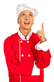 Amazed chef woman looking up Stock Photo