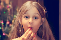 Amazed child looking at camera during Christmas holidays after receiving Christmas gift. Surprised child looking at camera during Christmas holidays after Stock Photography