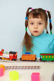 Amazed child and toy railway Stock Photography