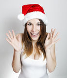 Amazed christmas girl. Amazed young pretty girl in a christmas hat Stock Images