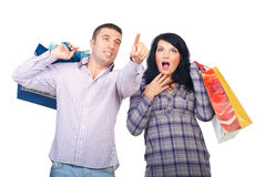 Amazed couple at shopping Royalty Free Stock Image