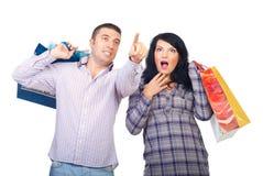 Amazed couple at shopping Royalty Free Stock Image