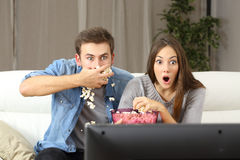 Amazed couple watching tv Stock Photography