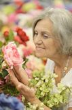Amazed elderly woman. Portrait of beautiful amazed elderly woman in summer garden Royalty Free Stock Photo