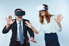 Amazed employees wearing virtual reality glasses Stock Images