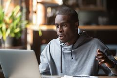 Amazed excited african man surprised by unexpected good news online royalty free stock images