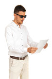 Amazed executive with sunglasses looking paper Royalty Free Stock Image