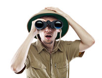 Amazed explorer looking through binoculars Royalty Free Stock Images