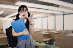 Amazed expression female student Stock Image