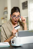 Amazed expressive woman shopping online Stock Photography