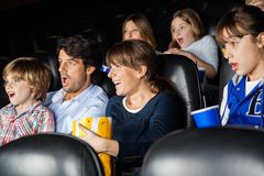 Amazed Families Watching Movie. In cinema theater royalty free stock images