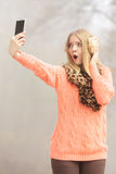 Amazed fashion woman in park taking selfie photo. Royalty Free Stock Photography