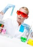 Amazed female doctor does experiment. Amazed female doctor in spectacles does some experiments, isolated on white stock photos
