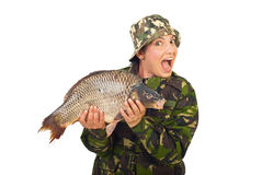 Amazed fisher woman holding big carp Royalty Free Stock Image