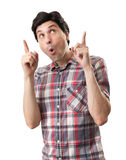 Amazed funny man pointing up Royalty Free Stock Photos