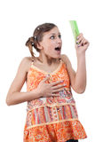 Amazed funny teenager looking comb over white back Stock Photography