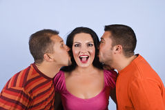 Amazed funny woman with two guys Stock Images