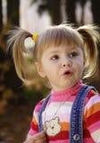 Amazed girl. In autumn park Royalty Free Stock Photos