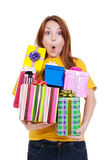 Amazed girl with gift boxes Stock Photo