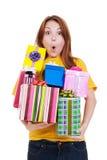 Amazed girl with gift boxes Stock Photo